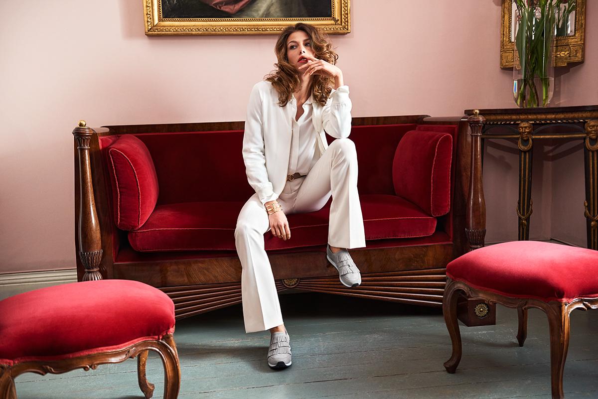 female model on a red sofa